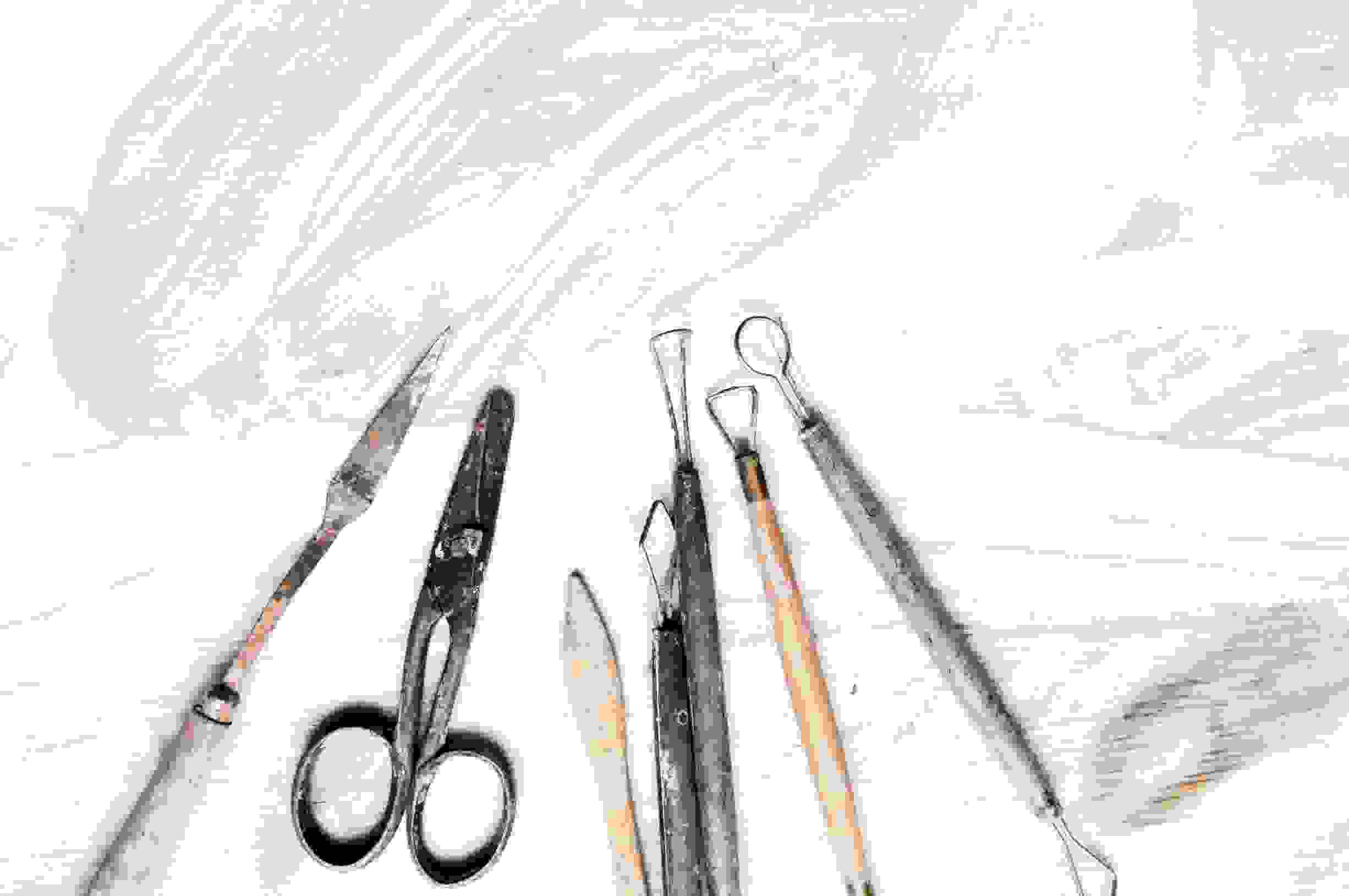 A selection of craft tools on a painted bench